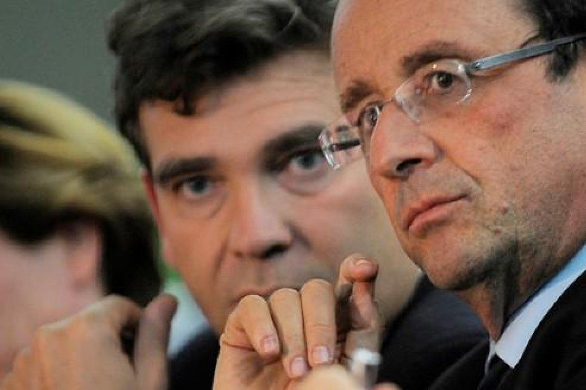 Hollande presentará un nuevo equipo, tras la dimisión de Arnaud Montebourg (al fondo en la imagen).